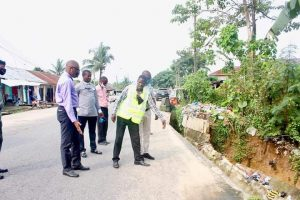 PHOTO: Commissioner for Environment & Petroleum Resources, Sir Charles Udoh inspecting the Erosion site