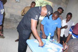Photo: Commissioner for Economic Development and Ibom Deep Seaport, Mr Akan Okon casting his vote