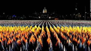 Images of the illuminated flags planted in the National Mall