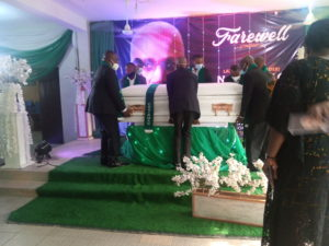 Remains of the late Umoren being carried by past Chairmen shortly after the lying-in-state